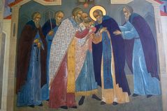 Religious painting on a church facade in Trinity Sergius Lavra in Russia. Color winter photo. Royalty Free Stock Images