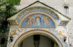 Religious painting on the front door of church Royalty Free Stock Photo