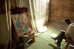 Religious paintings, Ethiopia. A religious painting with a man sat in front of it, Ethiopia Royalty Free Stock Images