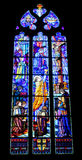 Religious picture on stained glass in the church Stock Photography