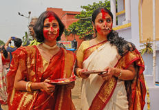 Religious Play With Vermilion. Beautiful Hindu women smear and play with vermilion during Sindur Khela traditional ceremony on the final day of Durga Puja Stock Photography