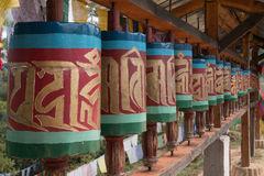 Religious prayer wheels, Bhutan Stock Photo
