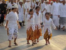 Religious procession in bali. Happy balinese kids in religious procession Royalty Free Stock Photo