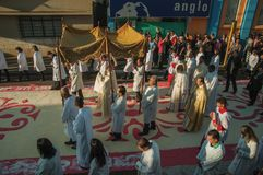 Religious procession on colorful sand carpet at the Holy Week. Sao Manuel, Brazil - May 31, 2018. Religious procession passing by a colorful sand carpet at the royalty free stock photos