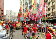 Religious Procession with Flags and Drums Stock Image