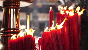 Religious red candle fire burning dancing in the wind in Longshan Temple, Taiwan Taipei stock video