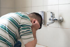 Religious Rite Ceremony Of Ablution Face Washing Stock Image