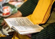 Religious scriptures. Religious book of an India wedding, sanskrit shloka written over it Stock Photos