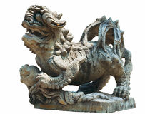 Religious sculpture dog dragon on a white background Stock Photo