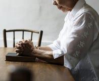 Religious senior woman are praying Stock Image