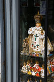 Religious souvenirs from Prague. Copies of the Infant Jesus of Prague, that is a 16th-century wooden statue of child Jesus holding a globus cruciger, located in Royalty Free Stock Image