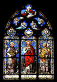 Religious stained glass mural. Stained glass window depicting Christian or religious images.  Vitre Church, Vitre, France Stock Photography
