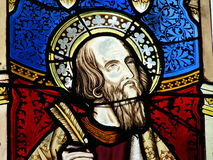 Religious stained glass window. Biblical figure on colorful stained glass window Stock Photo