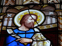 Religious stained glass window. Colorful biblical figure on stained glass window in church Royalty Free Stock Image