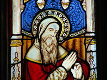 Religious stained glass window. Colorful biblical figure on stained glass window Stock Photos