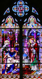 Religious Stained-glass Window. Church Stained-glass Window with religious scenes royalty free stock images