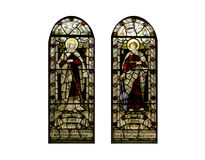 Religious stained glass windows, Cathedral. Religious stain glass windows with two panels.  Stained-glass-window on a white background at a cathedral building Stock Photo