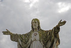 Religious Statue. Against a gloomy sky Royalty Free Stock Images