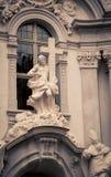 Religious statue and cross. In Durnstein Austria Stock Photo