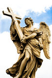 Religious statue from Rome. A religious statue of Angel with cross from a bridge in Rome royalty free stock photography
