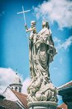 Religious statue, Sopron, Hungary, analog filter. Religious statue, Sopron, Hungary. Religious architecture. Travel destination. Analog photo filter with Royalty Free Stock Photo