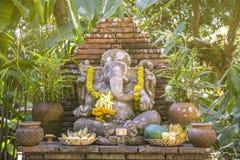 Religious stone sculpture of Ganesha god in garden, Thailand. Stock Photography
