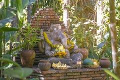 Religious stone sculpture of Ganesha god in garden, Thailand. Royalty Free Stock Photo