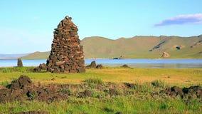 Religious stone structures on lakeshore stock footage
