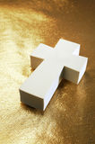 Religious symbol I. Cross on gold Stock Image