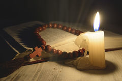 Religious theme candle with incense and holy book. Composition of religious theme candle with incense and holy book Royalty Free Stock Image