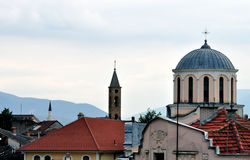 Religious Tolerance. Church and Mosque in Kosovo close to each other Royalty Free Stock Photos