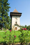 Religious tower. Surrounded by roses and fir trees royalty free stock photo