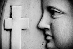 Religious wall detail. With face and cross Royalty Free Stock Photos