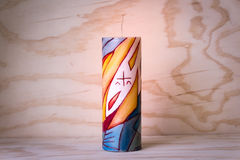 Religious wax candle with symbols. Photograph of a religious wax candle with symbols Royalty Free Stock Photo