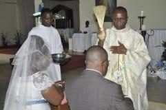 RELIGIOUS WEDDING COUPLE OF AFRICAN Stock Photos