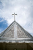 Religious white wooden cross on decorative church rooftop Royalty Free Stock Photos