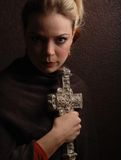 Religious woman. Holding a cross Royalty Free Stock Images