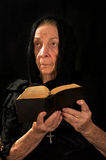 Religious Woman. Old Catholic nun in prayer holding bible and rosary Stock Photos