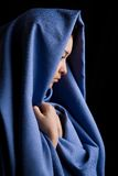 Religious woman. Portrait of pensive religious woman on a black background stock photos