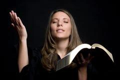 Religious Woman. Pretty religious woman holding bible stock photos