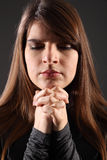 Religious woman eyes closed hands clasped praying Royalty Free Stock Photos