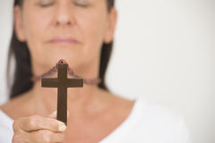 Religious Woman holding crucifix Royalty Free Stock Photo