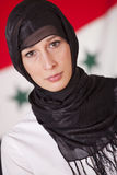 Religious woman over iraq flag Royalty Free Stock Images