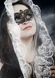 Religious woman with white veil in a position to pray Stock Photo