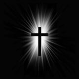 Religioush cross with sun rays  shine on the dark  background Royalty Free Stock Photography
