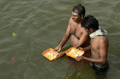 RELIGOUS CEREMONY AT SRIRANGAM. People take holy dip & rituals performing in kavary river for salvation of ancestors souls Stock Photos