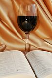 Religous Mass, wine and bible, concept background. Concept of religious Mass, with red wine as blood of Jesus and the holy pages of the Bible. Religious and love Stock Photos