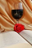 Religous Mass, wine, rose and bible, concept background. Concept of religious Mass, with red wine as blood of Jesus, red rose and the holy pages of the Bible Royalty Free Stock Photo