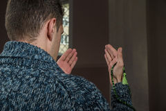 Religous person. Young religious person praying in amosque Stock Photography