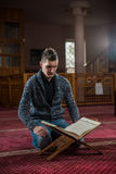 Religous person. Young religious person praying in amosque Royalty Free Stock Photo